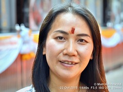 2015-10b Facing Thai Tilakas (11) (Matt Hahnewald) Tags: people facingtheworld thaibeauty beautiful navratri thailand watprasrimahaumathewee watkhaek hinduisminthailand colour travel eyecontact smiling asianwoman thaiwoman opentoallphotographers headshot ©matthahnewaldphotography ethnic ethnicportrait posing 43aspectratio primelens photography photo image horizontalformat portrait portraiture bokeh depthoffield temple colourful religion worldcultures cultural realpeople human humanhead humanface mouth lips nose facialexpression consent empathy rapport encounter emotion mood beauty environmentalportrait thaismile traveldestination tourism citydweller devotee festival female youngwoman incredible adorable gorgeous pretty nikkorafs50mmf18g tilaka humaneyes closeup street 50mmlens fullfaceview outdoor nikond3100