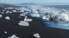 Gletscherlagune Jkulsarlon (Stefan Giese) Tags: ice strand island iceland meer panasonic iceberg gletscher eis schwarz kste wellen eisberg jkulsarlon fz200