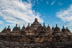 Temple Moment (Oliver J Davis Photography (ollygringo)) Tags: travel sky people heritage history tourism archaeology monument weather stone architecture clouds indonesia temple java construction ancient nikon couple asia southeastasia stupa buddhist religion buddhism tourists unescoworldheritagesite worldheritagesite nikkor archeology borobudur worldheritage contemplation magelang gupta d90 centraljava 9thcentury mahayana oliverdavisphotography oliverjdavisphotography