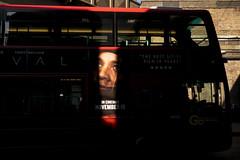 DSCF8101 (Dave Cavanagh Street) Tags: fuji xt1 fujixt1 london bus shadow eyes londonbus ad advertise street streetphotography fuji23mmf14