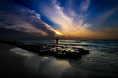 Fisherman at sunset - Tel-Aviv beach (Lior. L) Tags: fishermanatsunsettelavivbeach fisherman sunset telaviv beach sky silhouettes reflection reflections travel travelinisrael nature sea seascapes telavivbeach rocks clouds cloudysunset fishing