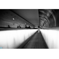 Renee, Walking Away. (D. Efram) Tags: bw paris subway blackwhite moving renee sidewalk bnw blackdiamond montparnesse
