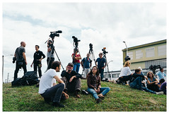 Jounalists and cameramen waiting for the debris of MH370, Toulouse, France (Bigmob Dontwannastop) Tags: camera woman man france grass plane waiting photographer crash debris tripod roundabout conversation boeing toulouse mound 777 journalist dga cameraman aeronautics balma ceat techinics mh370