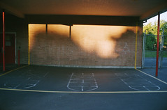 (Faulkner Short) Tags: school shadow red sun brick oregon portland konica hopscotch hexar
