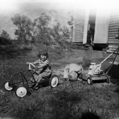 Farm play (dnskct) Tags: family people blackandwhite bw tree film garden gardening lawn maine 127 lawnmower brownie 1960s planting foundfilm october292015