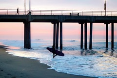 Morning Ritual (Madelynne F) Tags: surf huntington beach pier california surfing surfer waves sunrise light shimmer photography ocean morning soft love beautiful amazing boards reflection