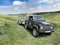 National Trust Land Rover Defender & Trailer. (ManOfYorkshire) Tags: park car wheel four drive countryside automobile 4x4 devils rover icon national trust land vehicle motor hillside dyke landrover southdowns defender vo10lfj