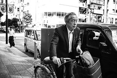 Tokyo_Street moving along (Vincent Albanese) Tags: life street light people bw woman sunlight man bike japan shop dark walking photography japanese fuji shadows candid transport sydney inspired streetphotography saturday australia pedestrian smoking explore adobe biking fujifilm midday learn shopfront brilliance lightroom amatuer shopkeeper allpeople presets 23mm mirrorless xpro1 inspiredeye lightroom5 xf23mm x100s xf27mm elephantgunpreset