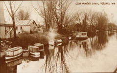 Canal Scene with Small Boats & Houses