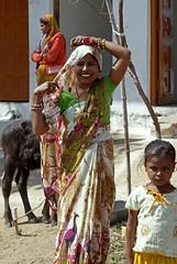Roadside Smile (cowyeow) Tags: street travel family people woman india girl smile composition asian asia pretty indian pradesh khajuraho madhyapradesh madhya indianwoman indiangirl