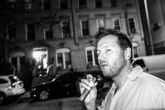 Summer Night (Beau Finley) Tags: street nyc summer ny monochrome brooklyn night smoke flash streetphotography cigar smoking russian unbuttoned slowsync ridgewood greepoint beaufinley unbuttonedshirt