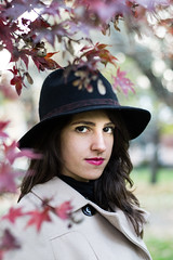 Emanuela (picco_benedetta) Tags: park autumn red portrait nature girl hat leaves foglie eyes outdoor young lips lipstick autunno ritratto