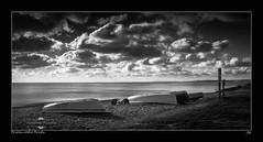 Branscombe Boats (jeremy willcocks) Tags: sea blackandwhite seascape beach sign clouds landscape boats mono east devon branscombe jeremywillcocks fujix100t southwestscenesmeuk