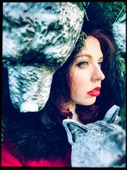Wolf Girl (elizunseelie) Tags: red portrait woman 6 tree girl up female fairytale self festive fur cool wolf close mask coat gothic makeup pale riding evergreen fir expressive hood plus lipstick growl tone wolves alternative snarl iphone selfie grimm lined incredibooth snapseed