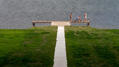 Image of a family at a pier on the river IJssel at Deventer Overijssel (Bart Ros) Tags: river water family ijssel deventer overijssel nederland holland couple people humans lines pier wood grass green grey