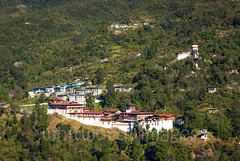 View to Trongsa (whitworth images) Tags: landscape himalaya mountains himalayas bhutan town scene fortress beautiful travel forest green broadleaf asia nature dzong beauty hills red small trees white valley trongsa steep remote monastery scenic building architecture environment isolated tiny outdoors traditional trongsadzongkhag