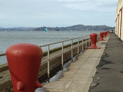 The Pier (Melinda Stuart) Tags: marin sail spinnaker red bollards marine fortmason sf ca waterfront pier dock bay water explored painted secure tieup