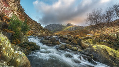 River runs deep (Einir Wyn) Tags: landscape mountainside mountain rocks river trees nikon nature natural nationaltrust colour color clouds light leaf lake water stream scenic wales snowdonia uk britain gold blue white