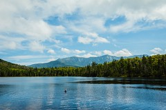 Lonesome Lake (mattbigwoods) Tags: mountains clouds sunny water child secluded lonesome lake nationalforest whitemountains