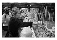 in search of good fortune (handheld-films) Tags: hongkong tao taoism siksikyuen wongtaisin fortune incense religion religious chinese culture pray prayer temple spirituality woman elderly old asia monochrome blackandwhite documentary travel sticks