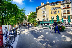 Old Town Square in Geneva, Switzerland (` Toshio ') Tags: toshio switzerland europe geneva geneve oldtown placedubourgdefour cafe restaurant people bicycle street road city history european fujixe2 xe2