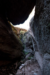 outside of your walls passes real life (Super G) Tags: nikon292 pinnaclesnationalpark cave stairs rock dark light entrance exit