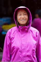 Magenta Rain Coat (Pexpix) Tags: bobo female girl lady nikkoraf85mmf14d nikondf rain raining weather wet woman xia raincoat dali yunnan china cn 攝影發燒友