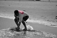 DSC_0175 (Travis Schuldt) Tags: blackandwhite beach water monochrome sport washington seaside movement sand outdoor pacificnorthwest pnw skimboarding bnw skimboard skimming