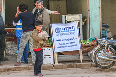 A boy in Ariha, Idlib, collects free for his family (Ummah Welfare Trust) Tags: poverty children war islam aid hunger arab syria humanitarian إدلب، سوريا‭‬