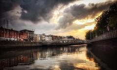 Liffey sunset (janetmeehan) Tags: bridge liffey river water streetscene streetphotography street redlections sky cityscape city sunset ireland dublin