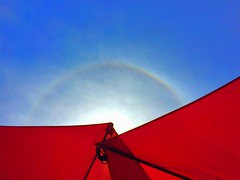 Abstract: Sun dog and overlapping red umbrellas (peggyhr) Tags: peggyhr umbrellas red sky sundog halo bluebirdestates alberta canada abstract infinitexposurel1 super~sixbronzestage1 thegalaxy