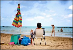 Bay Watching (Steve Lundqvist) Tags: open sea mare sand spiaggia beach seaside adriatico adriatic italia italy watching bay sitting sunchair chair landscape people nikon nikkor 105mm explore inexplore relaxing relax coast