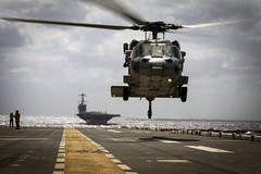 An MH-60S Seahawk takes off from the flight of USS Iwo Jima. (Official U.S. Navy Imagery) Tags: jtfmatthew ussiwojima iwojima amphibious amphib norfolk mayport hurricane matthew disaster navy meu 24th marine relief aid humanitarian mh60 knighthawk hsc squadron helo helicopter mv22b osprey vmm atlanticocean