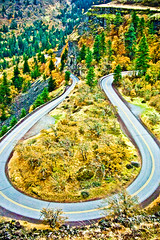 Highway 30 in Fall from Rowena Overlook-Columbia River Gorge  Fall Color along curving section of Highway 30 below Rowena Overlook in the Columbia River Gorge National Scenic Area (Smoky Bear Photog) Tags: bicycling bikeriding boulders cliff columbiarivergorgenationalscenicarea driving environmental facilities fallcolor fence geological highway30 natureviewing oregon pinetrees road rowenaoverlook scenic trees usforestservice unitedstatesofamerica
