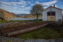 The workshop. (Siggi007) Tags: train rail railroad rails nature sky colors blue sea fjord building buildings workshop garage trees clouds view water landscape landschaft abandoned old mood mountains canon norway norwegen noruega autumn fall canon6d outdoor