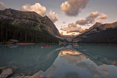 Red canoe on Lake Louise (Patty Bauchman) Tags: glacier lakelouise mountainlake albertacanada banffnationalpark victoriaglacier earlymorninglight sunriselake glacierfedlake lakelouisesunrise redcanoeatdawn