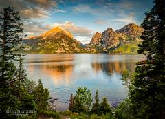 Sunrise at Jenny Lake (Greg Lundgren Photography) Tags: morning travel summer lake mountains reflection sunrise dawn nationalpark wyoming grandtetons goldenhour jennylake greglundgren
