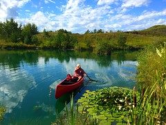 Perfect day for a re-launch! (peggyhr) Tags: trees red summer lake canada clouds reflections canoe hills alberta grasses peggyhr bluebirdestates