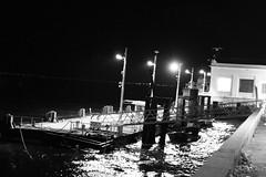 last night in Lisbon (Stabilokoko) Tags: street light shadow sea blackandwhite bw portugal water ferry night dark dangerous arty harbour lisbon mysterious tejo withoutpeople