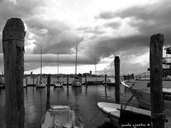 clouds (paolo agostini) Tags: bw canon boats lagoon barche bn laguna pali chioggia sottomarina s95 lusenzo canonpowershots95
