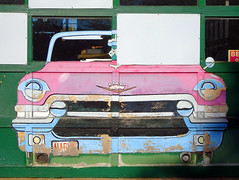 Roland's Auto Garage Door (Jae at Wits End) Tags: auto door old building green art texture abandoned broken window glass car architecture painting advertising outside marketing mural automobile midwest paint exterior outdoor decay cartoon ad neglected stlouis entrance structure doorway forgotten american missouri transportation worn vehicle weathered opening portal aged discarded forsaken saintlouis damaged rejected entry decayed