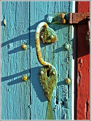 old door handle (theodehaan) Tags: door blue red green shadows decay rusty nails doorhandle