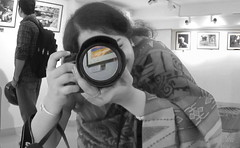 in an exhibition (asim chaudhuri(anurupa_chowdhury_yahoo.co.in) Tags: candid exhibition photograoher