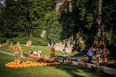 Acrobatics (Melissa Maples) Tags: ludwigsburg germany europe nikon d5100   nikkor afs 18200mm f3556g 18200mmf3556g vr residenzschloss palace blhendesbarock garden summer krbisausstellung pumpkins pumpkin festival sculpture art circus pyramid acrobats
