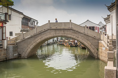 one man, one bridge (stevefge) Tags: china shanghai zhujiaujiau watertown bridges canal water arch architecture stone reflections people candid street reflectyourworld
