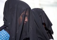 Iranian shiite muslim women with their faces hidden by a veil mourning imam hussein on tasua during the chehel manbar ceremony one day before ashura, Lorestan province, Khorramabad, Iran (Eric Lafforgue) Tags: 2people adultsonly ashura ceremony chador clothing colorimage covered face female hidden horizontal hussain imamhussein iran islam khorramabad middleeast mourners mourning muharram muslims mysterious mystery niqab outdoors people persia religion religious ritual shia shiism shiite tasoua tasua tradition traditional twopeople veiled woman women womenonly lorestanprovince