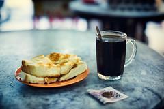 Kaya Butter Toast and Kopi O Kosong (Jon Siegel) Tags: nikon nikkor d810 50mm 12 nikon50mmf12 toast kaya butter kopi coffee blackcoffee spoon money coins bills food dining afternoon singapore singaporean heapsengleongcoffeeshop heapsengleong