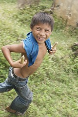 A wealth of happiness (Pejasar) Tags: boy smile goatherder child shirtless goadsticks eltesoro guatemala wealth poverty joy happiness