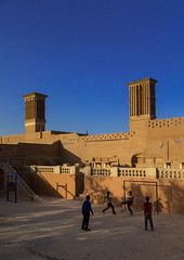 Children playing football in front of ind towers used as a natural cooling system in iranian traditional architecture, Yazd province, Yazd, Iran (Eric Lafforgue) Tags: 4people architectural architecture badgir building buildingexterior builtstructure childrenonly colorimage coolingsystem copyspace cultural culture day field football fourpeople fullframe game iran kids middleeast orient outdoors persia playing tourism touristic tower tradition traditional travel urban vertical windcatcher windtower yazd yazdprovince ir