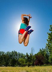 Time spent in the air. (Flickr_Rick) Tags: summer woman girl outside jump jumping legs bluesky jumpology